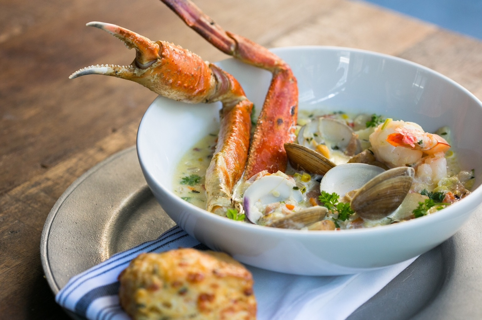 Seafood Chowder:  Shrimp, scallops, fish, crab + grilled corn $22