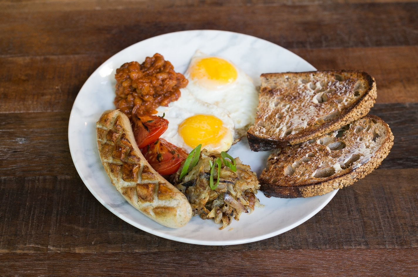 Drake Breakfast: Fried eggs, hash browns, roasted tomatoes, banger, baked beans $12.95