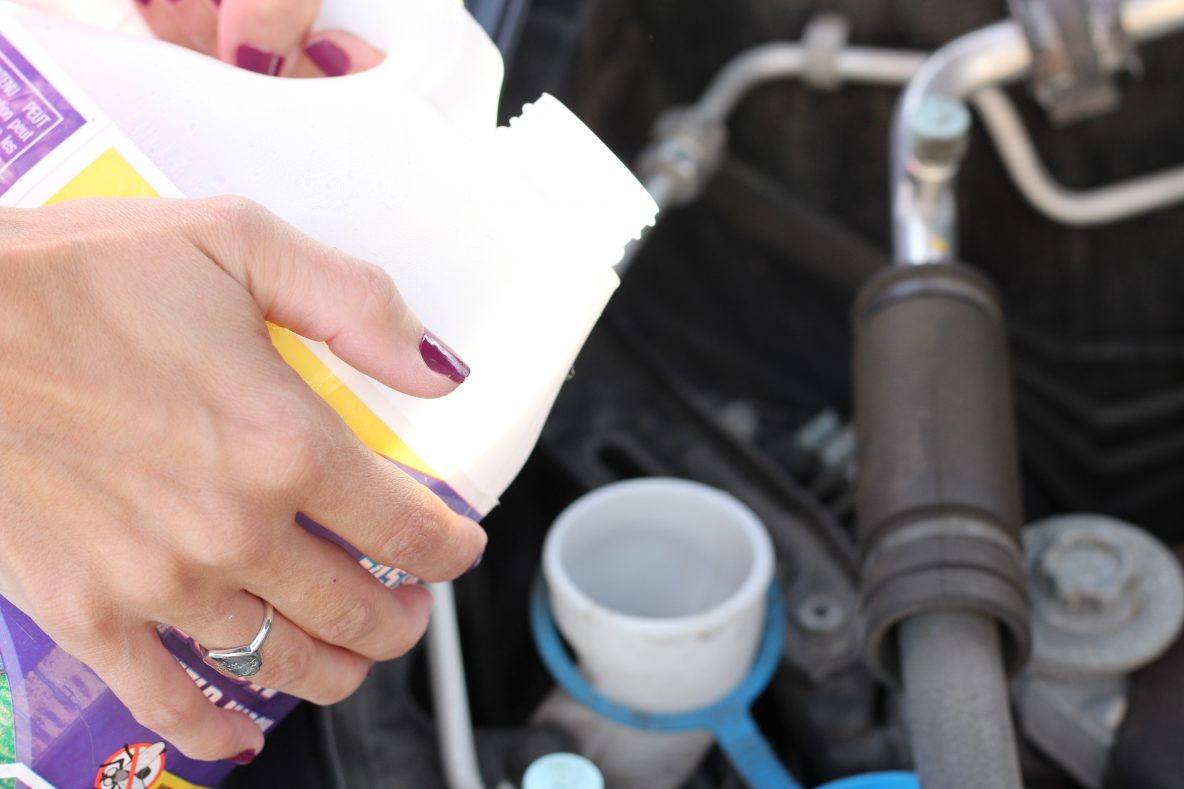 image of pouring windshield washer fluid