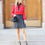 red frilled blouse with pleated faux-leather skirt mandy furnis