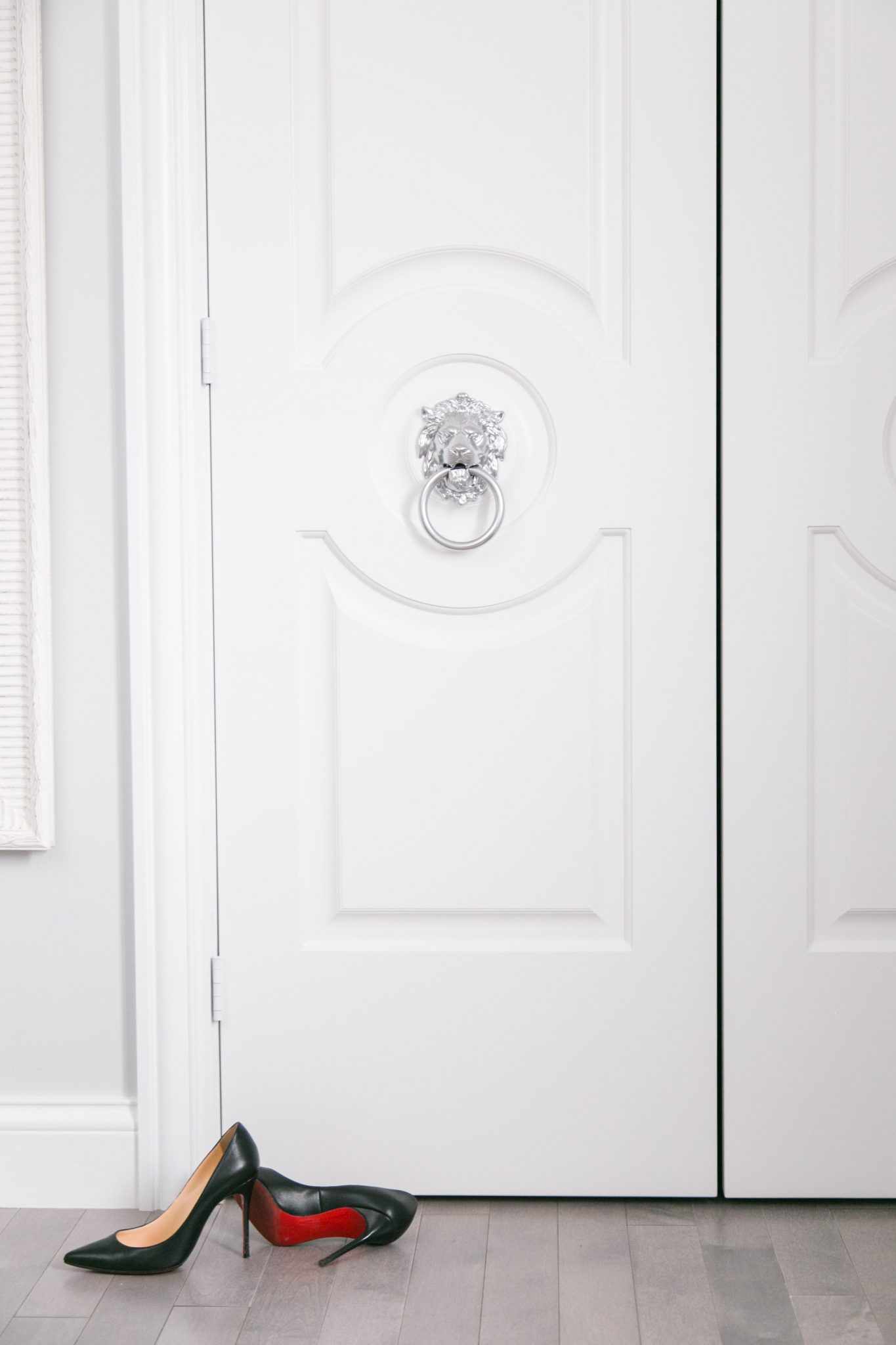 Metric Walk-In closet doors with chrome Lion Head knockers and Christian Louboutins