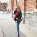 Oversized scarf with cable-knit sweater distressed jeans and Chanel bag