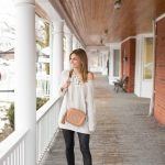 Neutral winter look with lace up off the shoulder sweater, pleather leggings and nude cross body bag