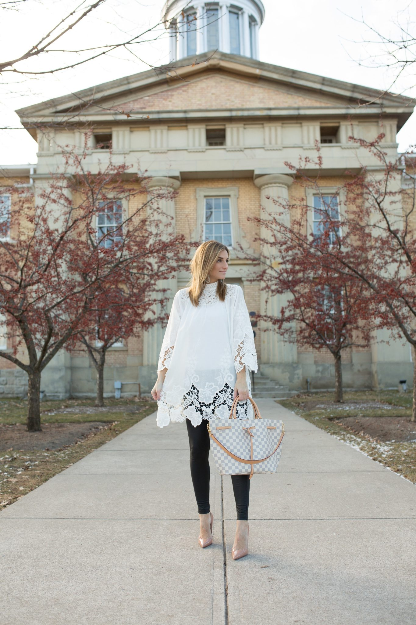 White Tunic with cut out detail, pleather leggings, nude Christian Louboutin heels, Louis Vuitton Girloata Bag