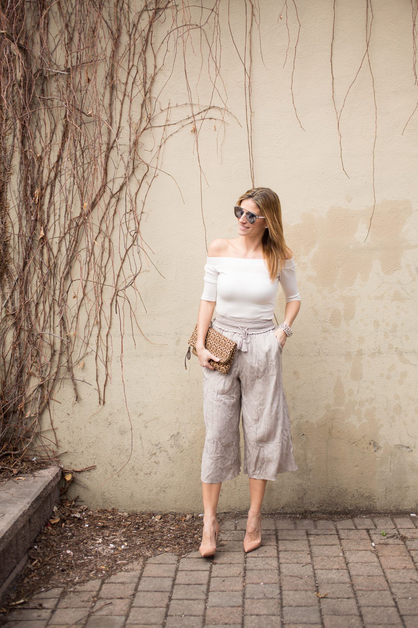 Lucky 7 Ribbed Off the Shoulder Top Jean Machine, Wilfred Nanterre pants from Aritzia, Nude Christian Louboutin pumps, Dior So Real Sunglasses, leopard print clutch from Charming Charlie