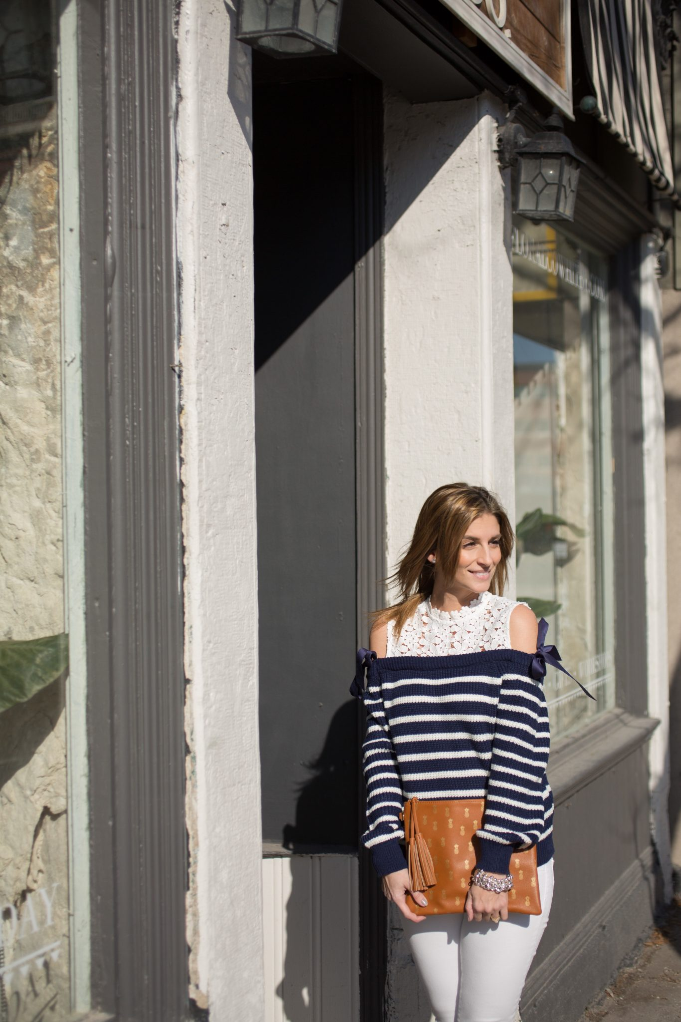 Chicwish Sweet Evocation Cold-shoulder Sweater in Navy Stripes, white jeans, black suede boots, pineapple clutch