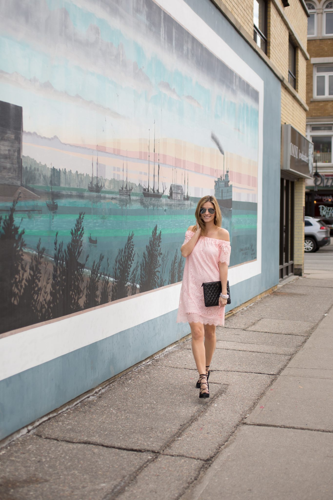 Pink lace off the shoulder dress from Suzy Shier, Chanel black quilted clutch, black suede lace up pumps, Ray-Ban Aviators