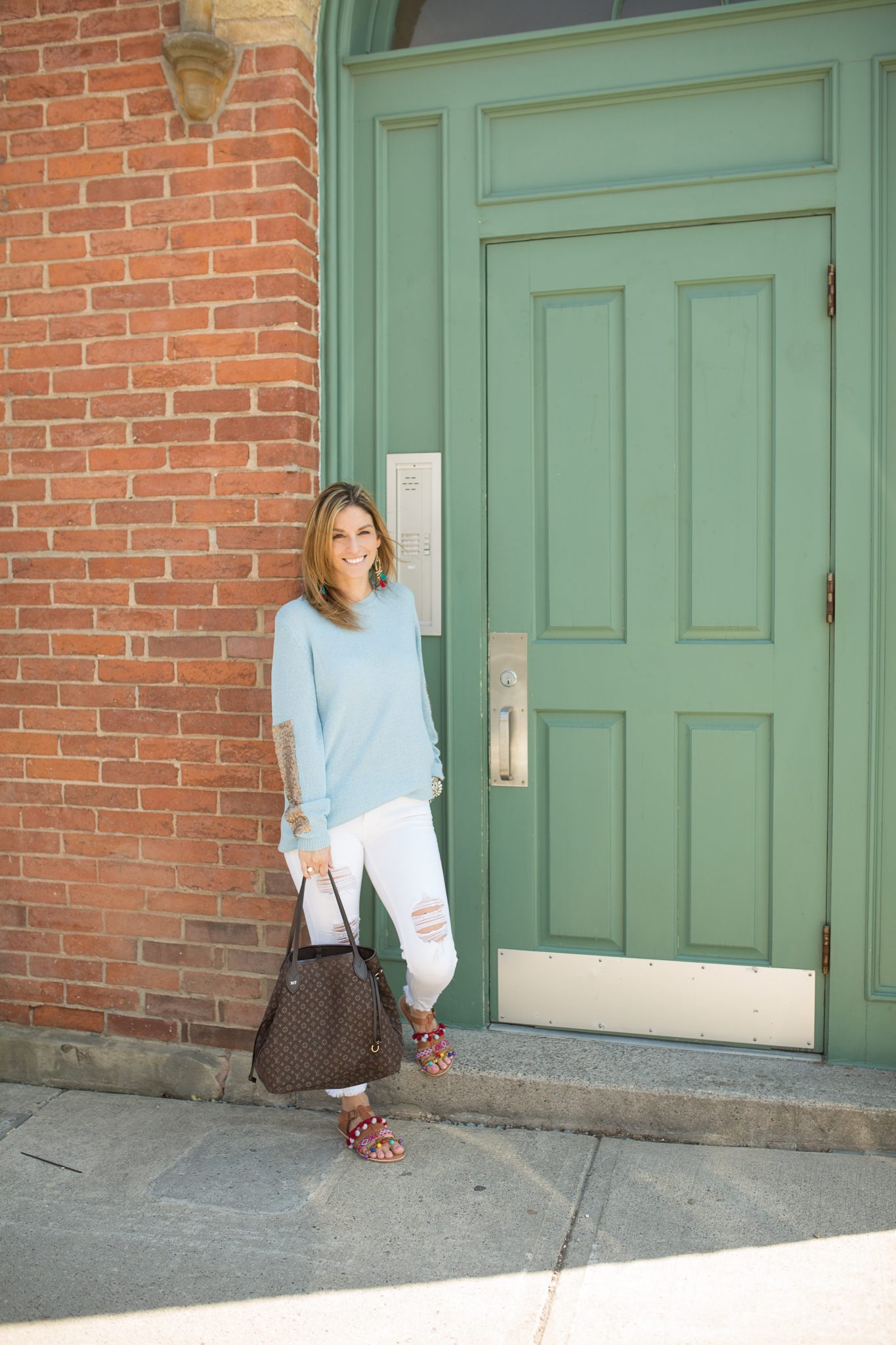 Pink Blush Light Blue Sequin Accent Sleeve Knit Sweater, white distressed jeans from Jean Machine, Charlotte Tassel and Pom pom sandals, Louis Vuitton Neverfull