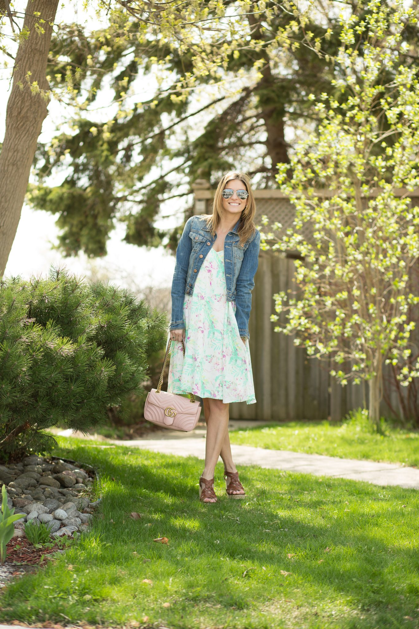 Perfect floral dress from Pink Blush with a jean jacket for spring weather