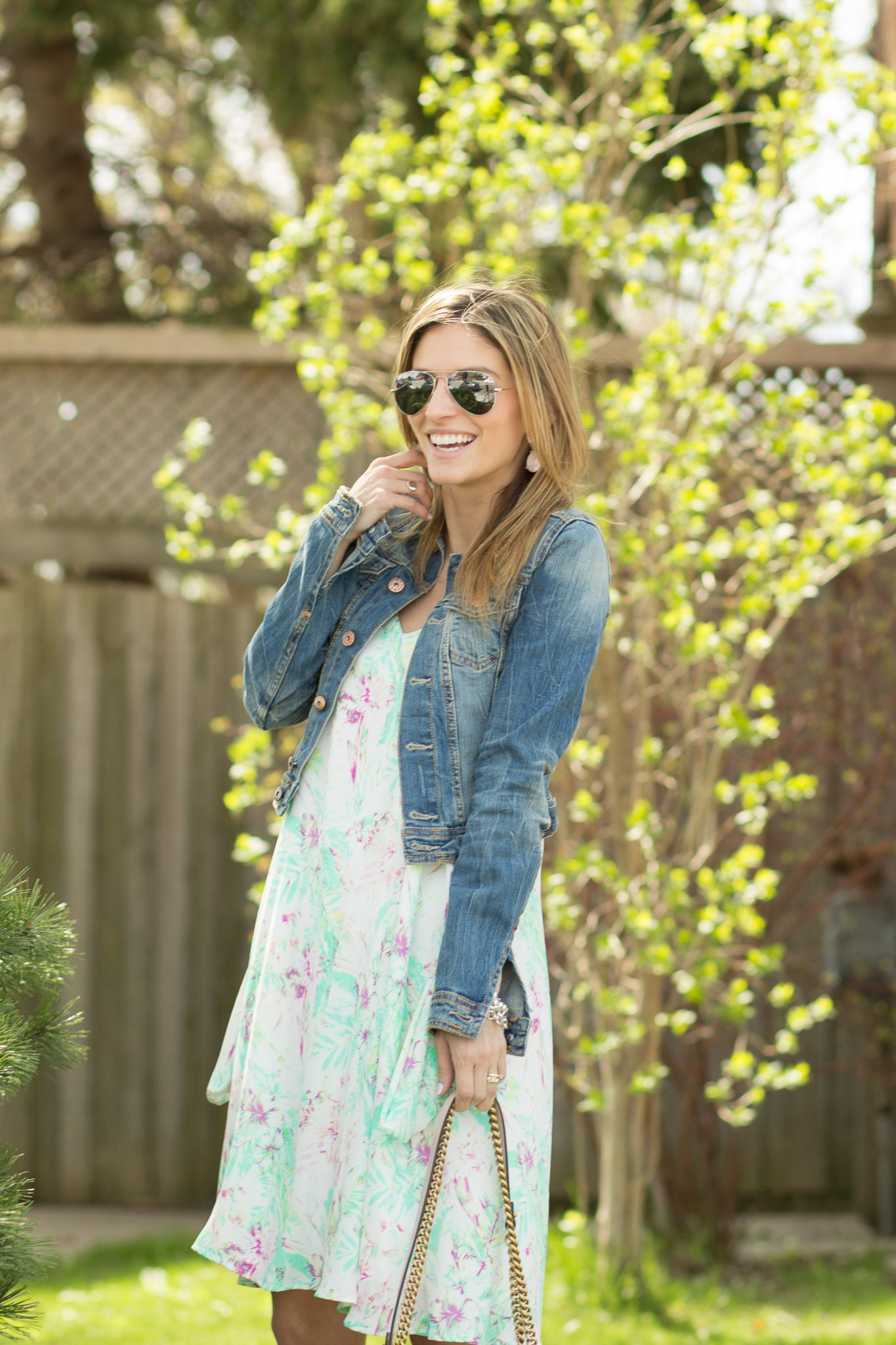 spring blogger style with floral dress and jean jacket