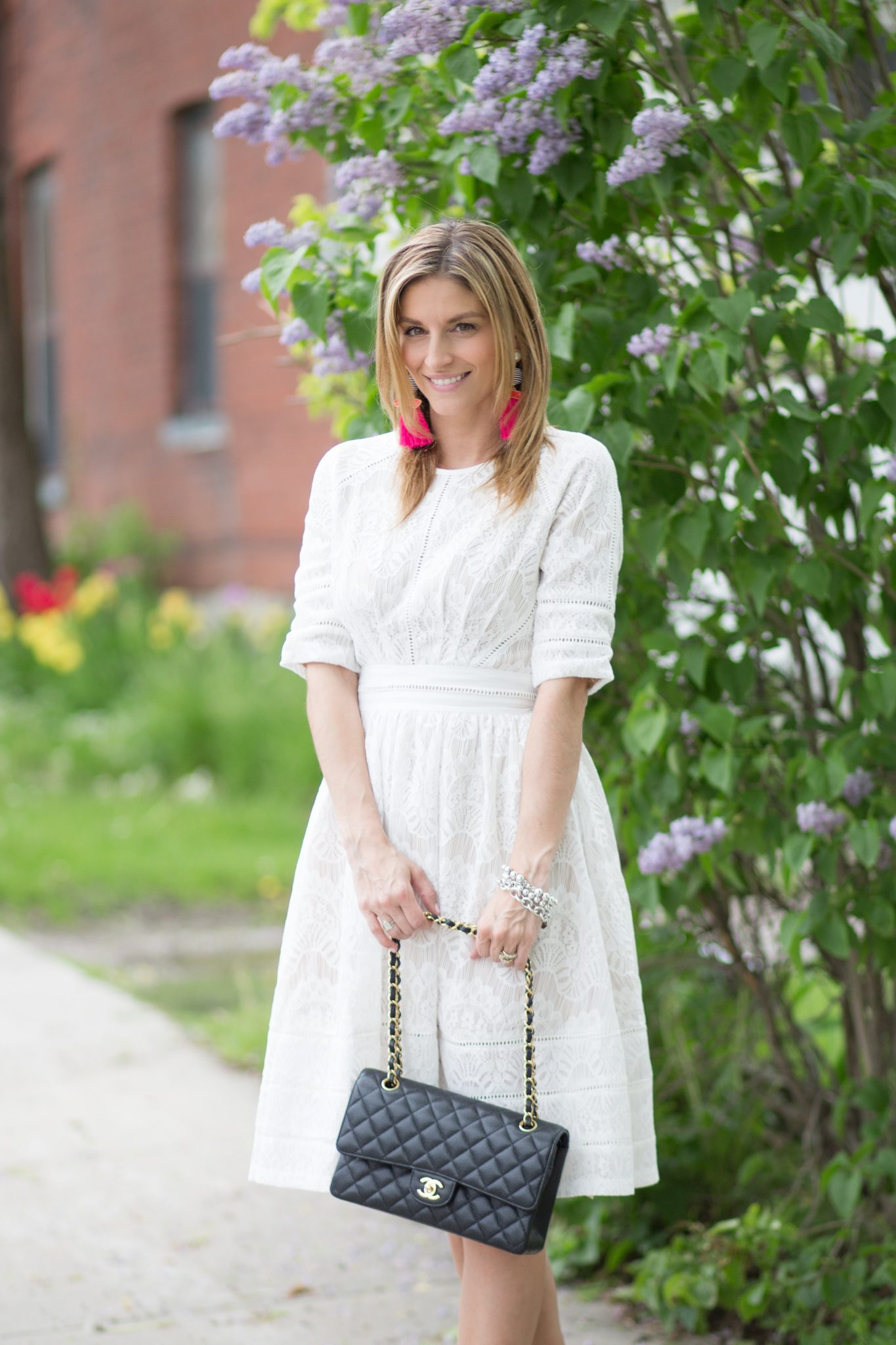 White lace dress from Zaful, suede lace up pumps, Chanel medium flap bag, pink tassel earrings