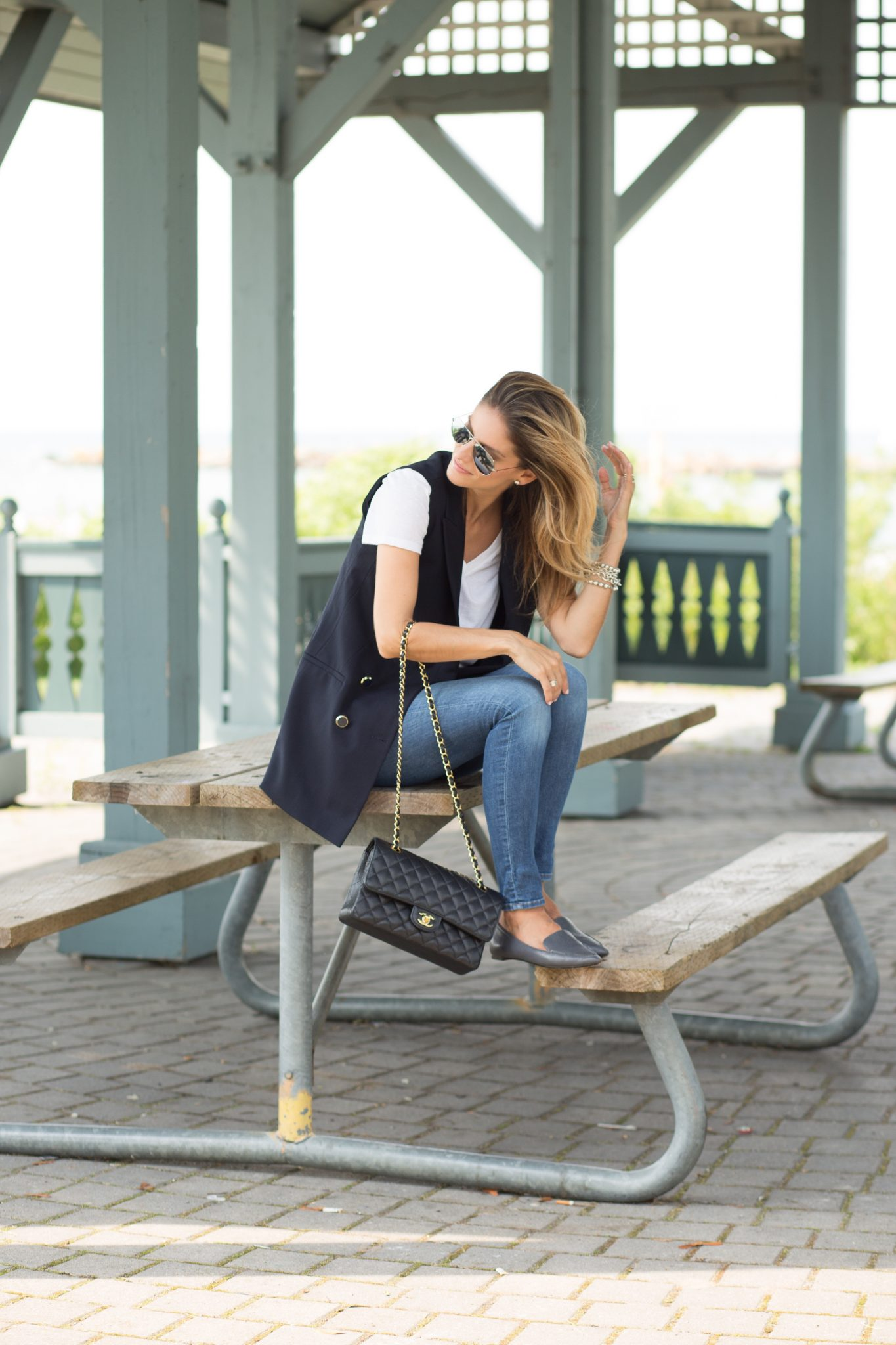 fall transitional look with blue military vest