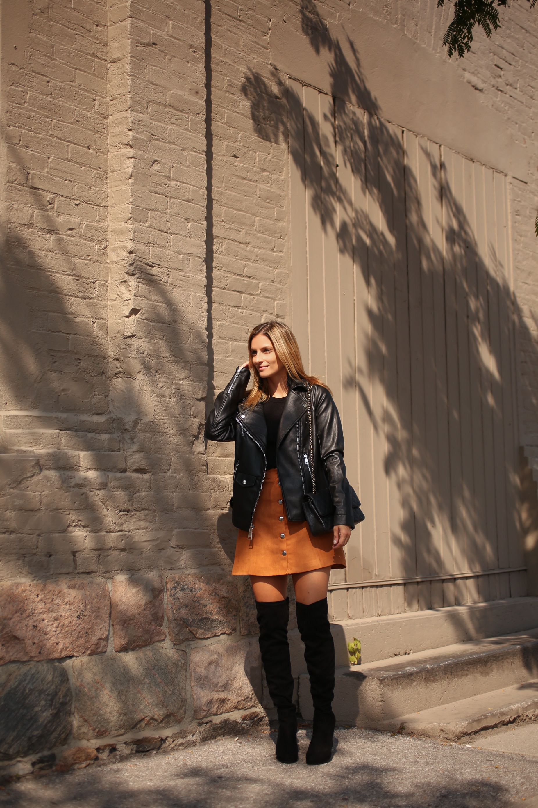 styling over the knee boots with a skirt