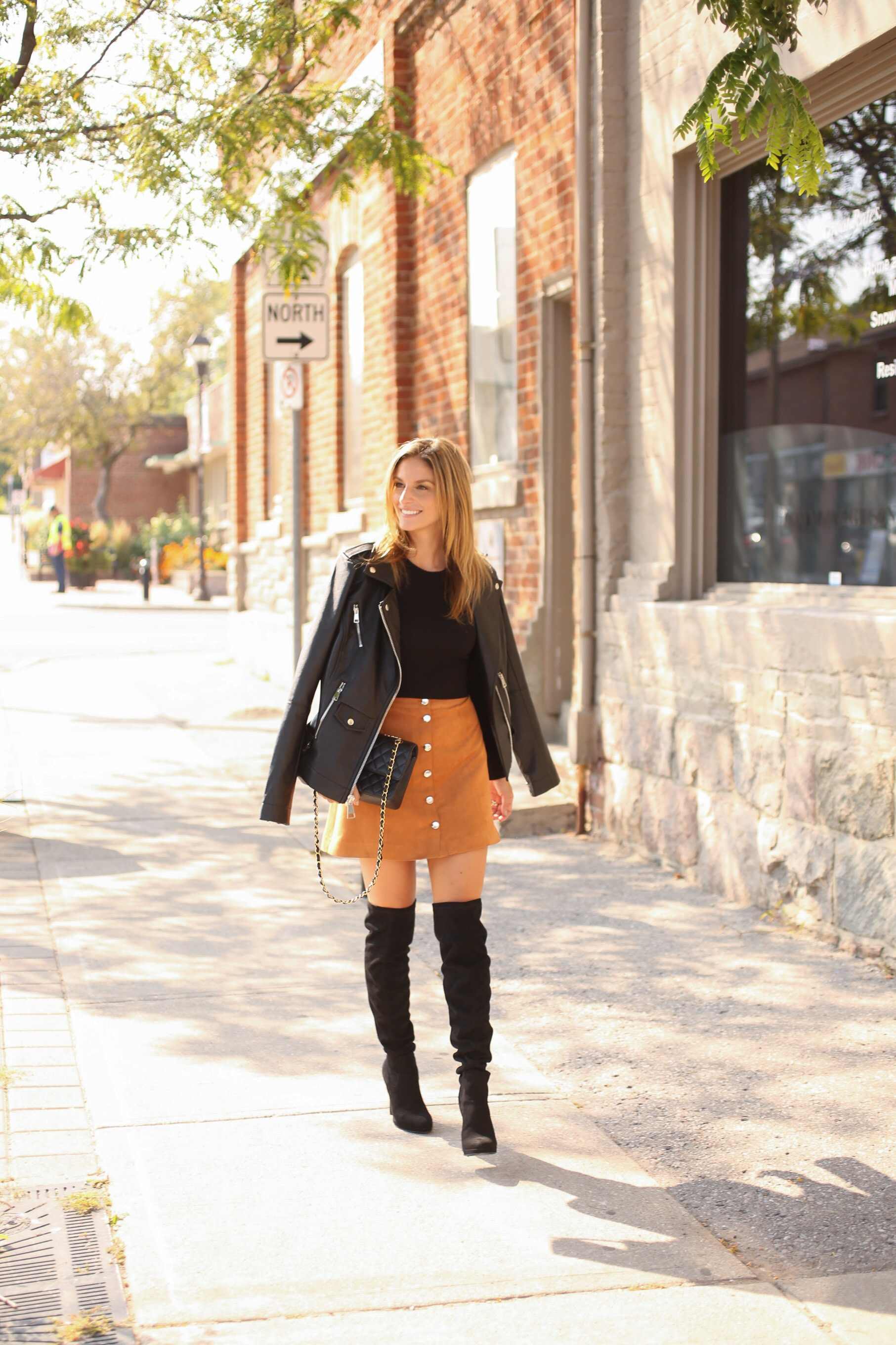 Button down suede skirt, black sweater, leather jacket, black over the knee boots