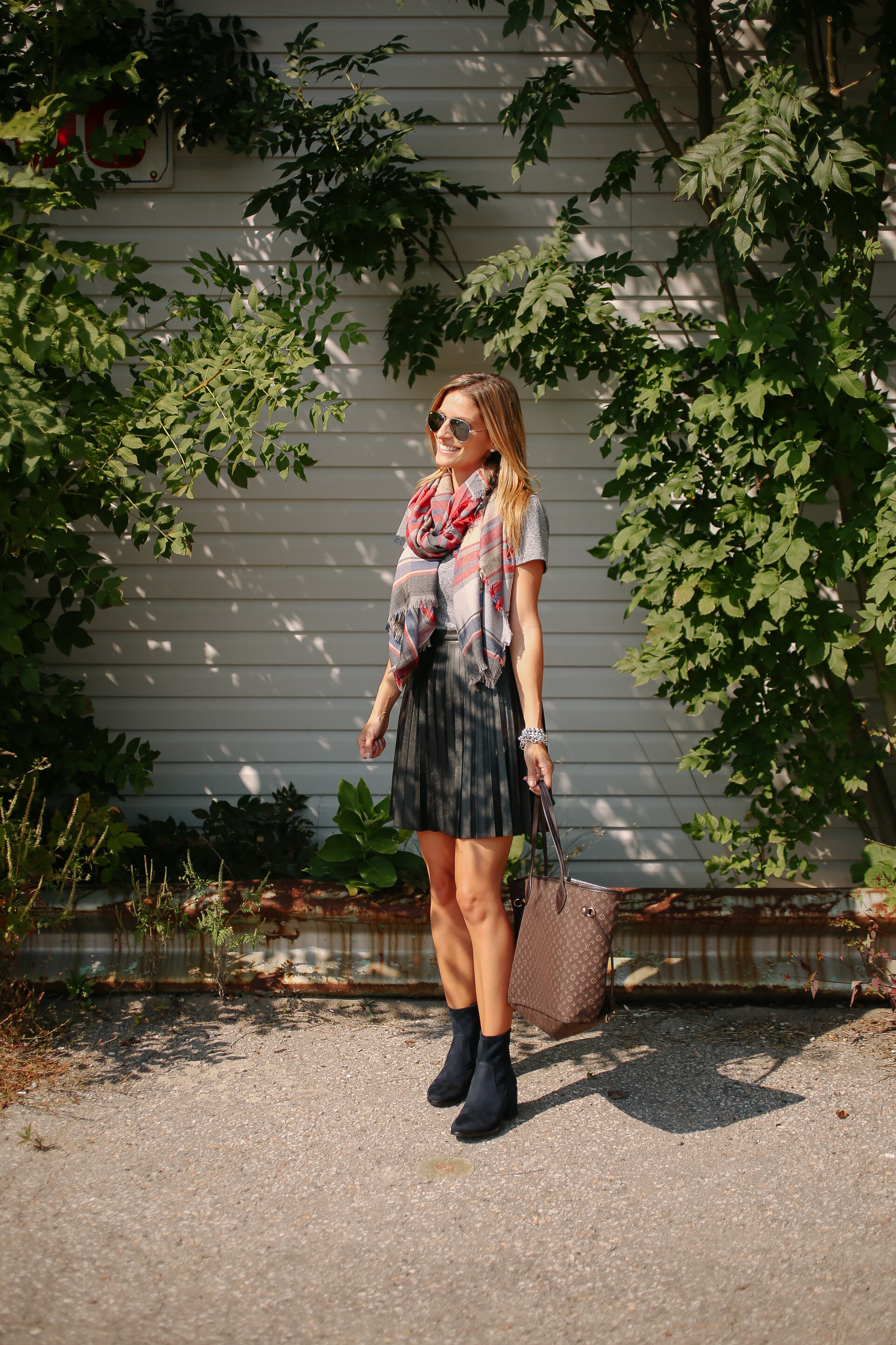 fall look with booties, leather skirt, t-shirt and plaid scarf