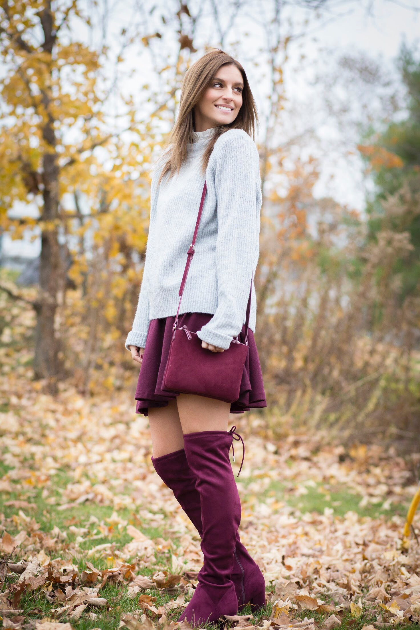 stylish blogger look for the holidays - fall style with burgundy skirt, burgundy over the knee boots, and grey sweater sparkleshinylove mandy furnis