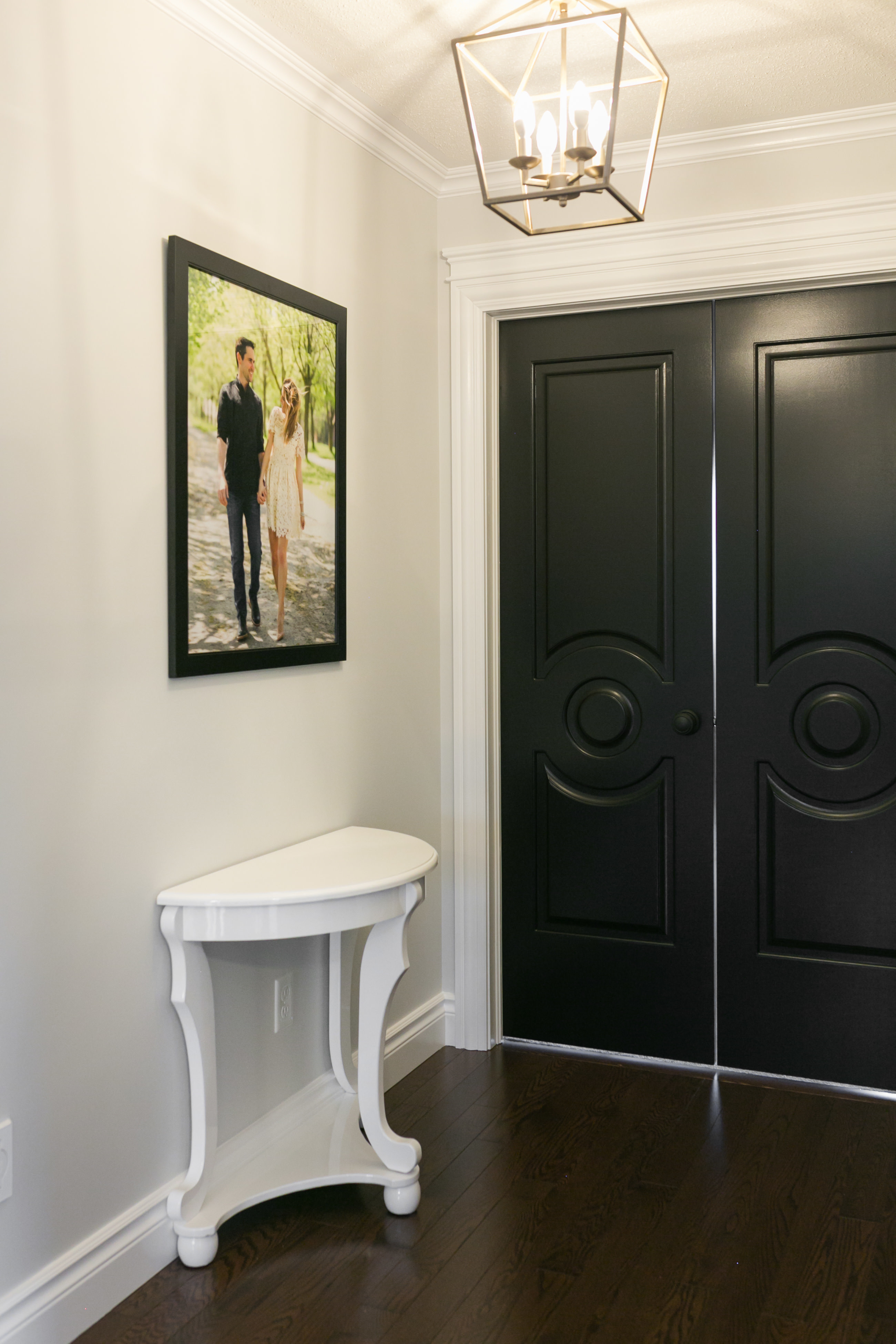 Long white hallway with painted black doors metrie sparkleshinylove