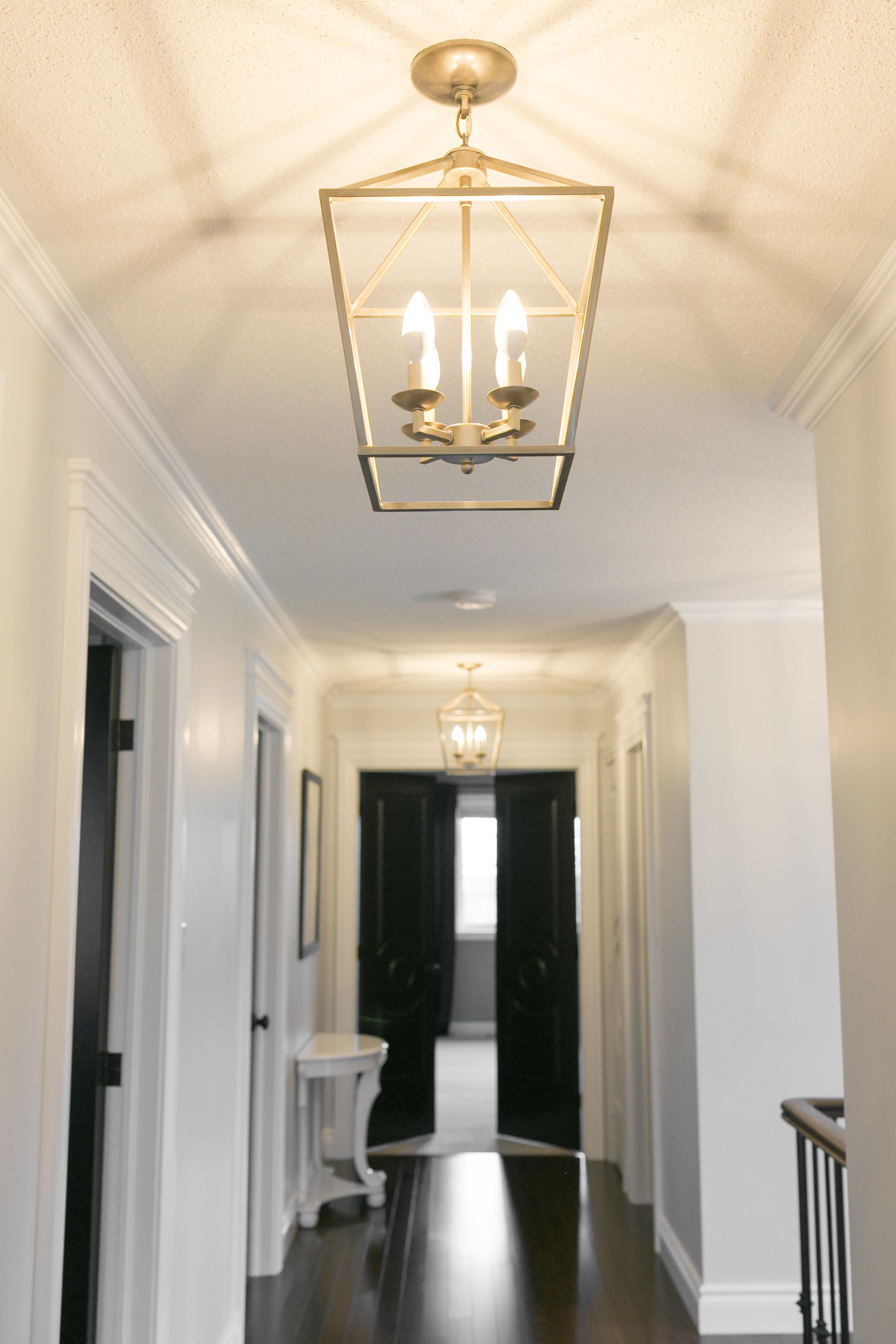 white hallway with black doors sparkleshinylove metrie