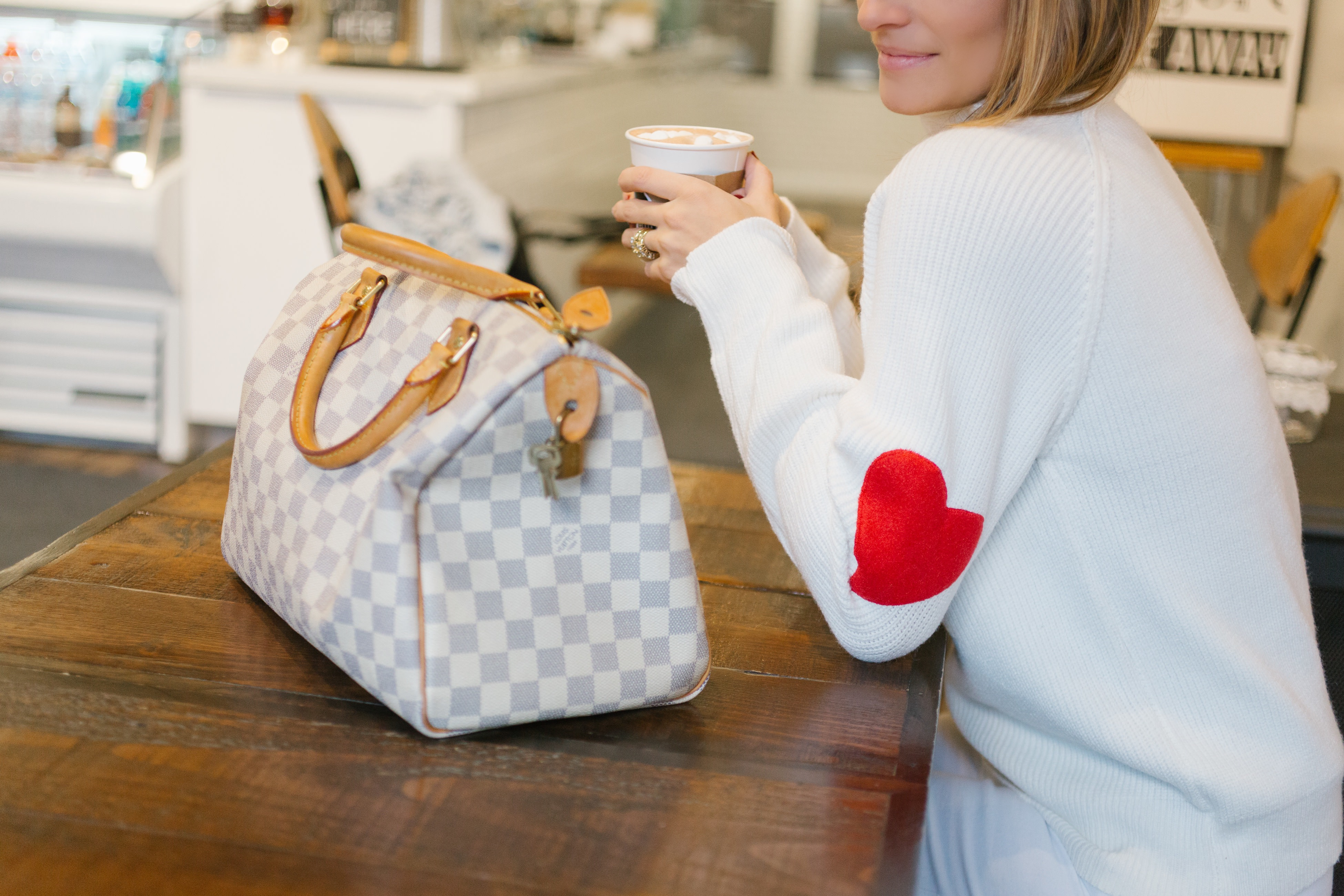 Chicwish heart elbow patch sweater, white jeans paired with brown suede boots and louis Vuitton speedy Mandy Furnis sparkleshinylove