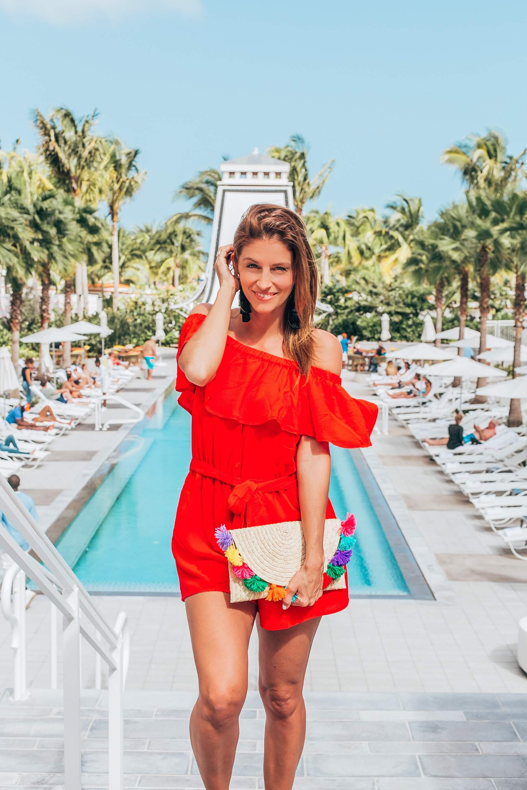 Red romper for summer with tassel clutch and espadrilles what to wear on vacation sparkleshinylove mandy furnis