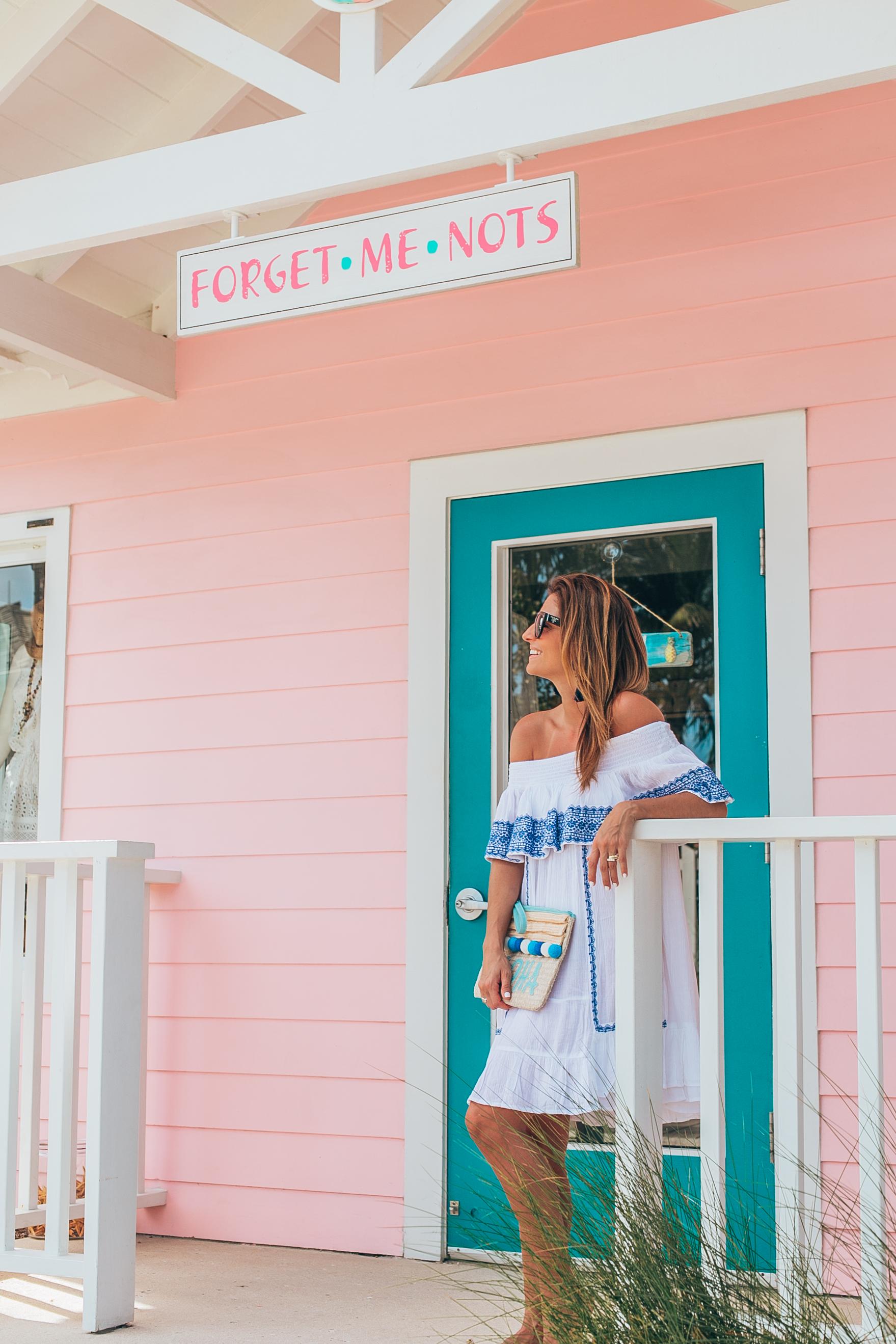 Perfect white and blue off the shoulder dress with valentino rockstud flip flops and Aloha pom pom bag; baha mar resort Bahamas; mandy furnis sparkleshinylove