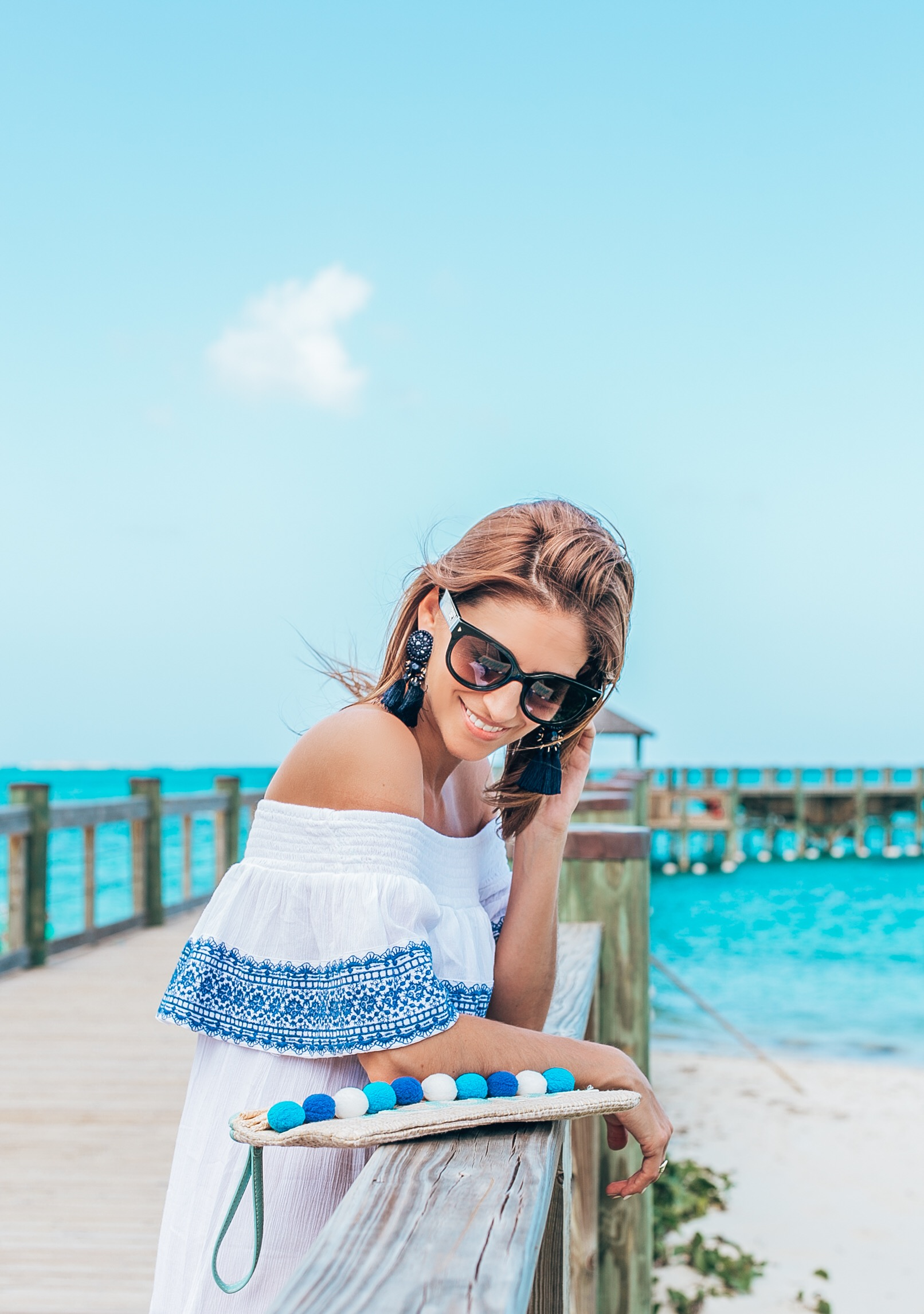 Perfect white and blue off the shoulder dress with valentino rockstud flip flops and Aloha pom pom bag; baha mar resort Bahamas; mandy furnis sparkleshinylove