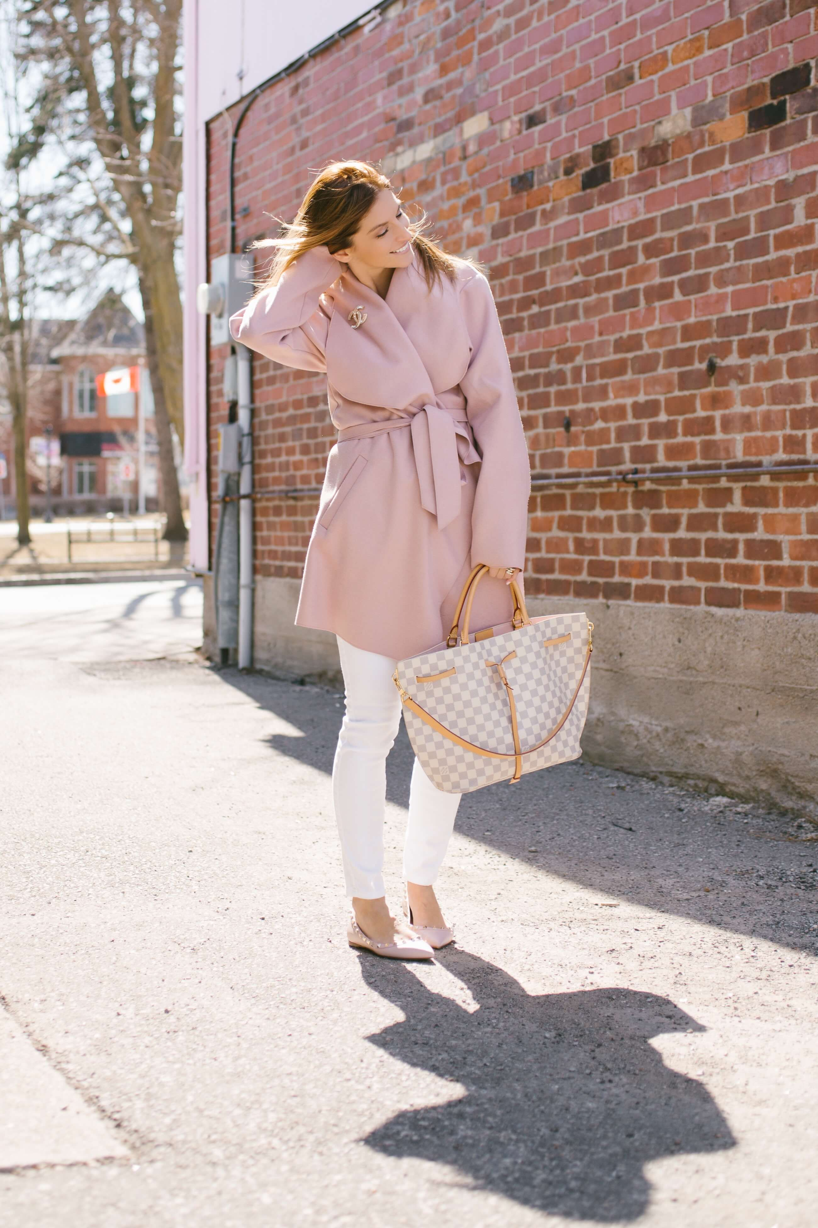 Pink Valentino rockstud flats, white seven for all mankind jeans, pink wrap coat, chanel broach, louis vuitton girolatta bag mandy furnis sparkleshinylove