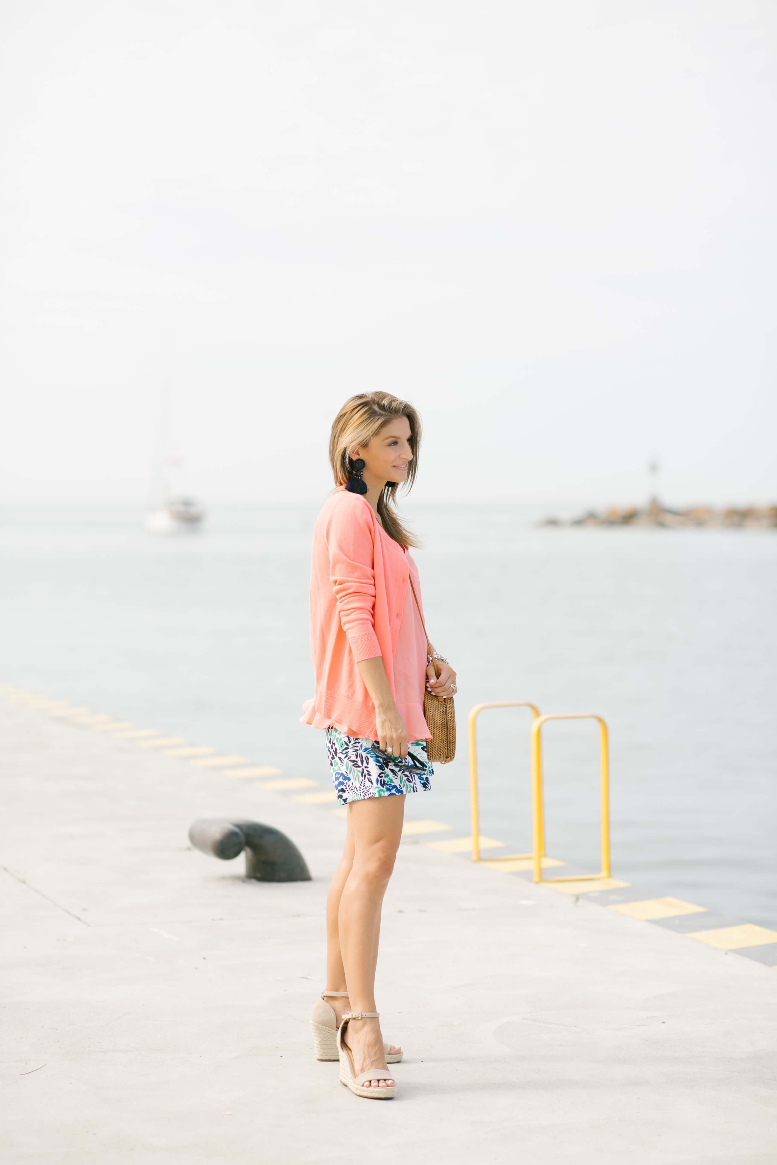 Easy summer look with patterned shorts, coral cami, and coral cardigan with tassel earrings and straw bag; sparkleshinylove colourful summer look