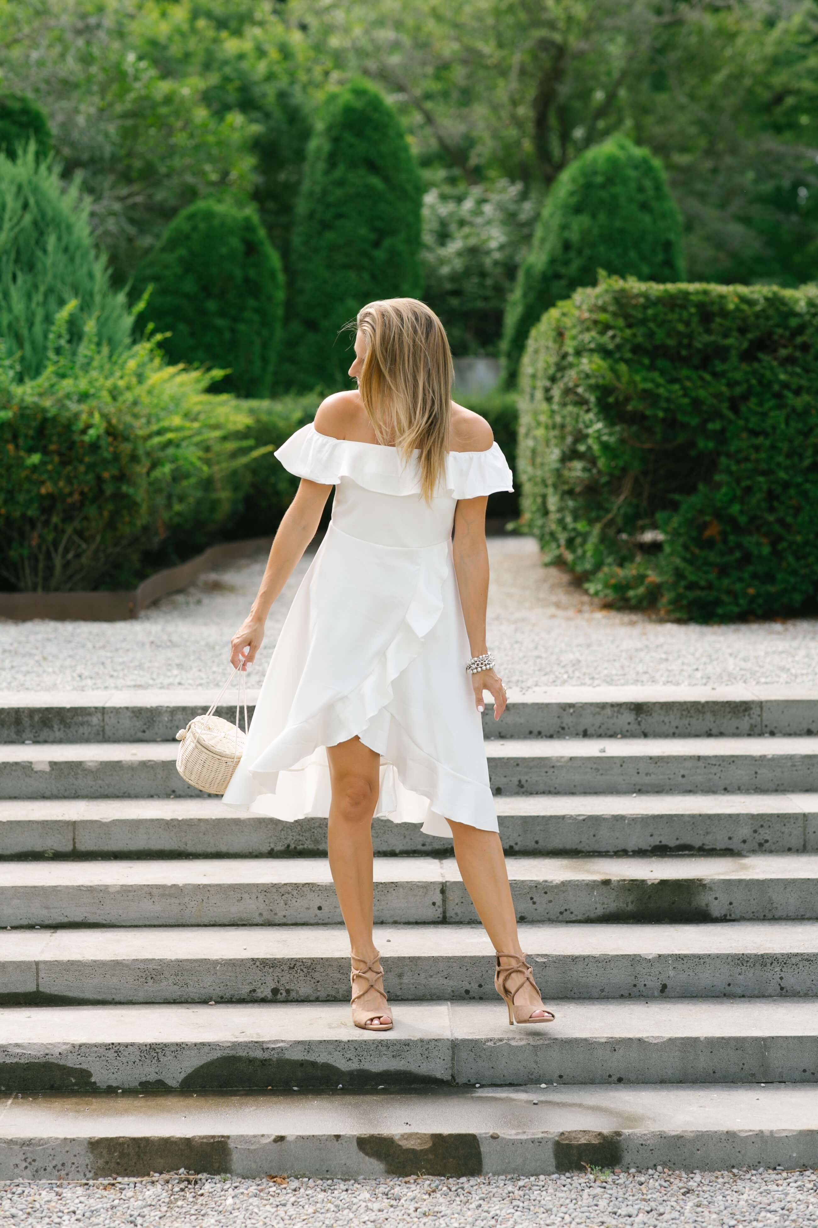 White off the shoulder ruffled dress, wicker basket bag; style for a wedding; pretty white dress; whitby blogger