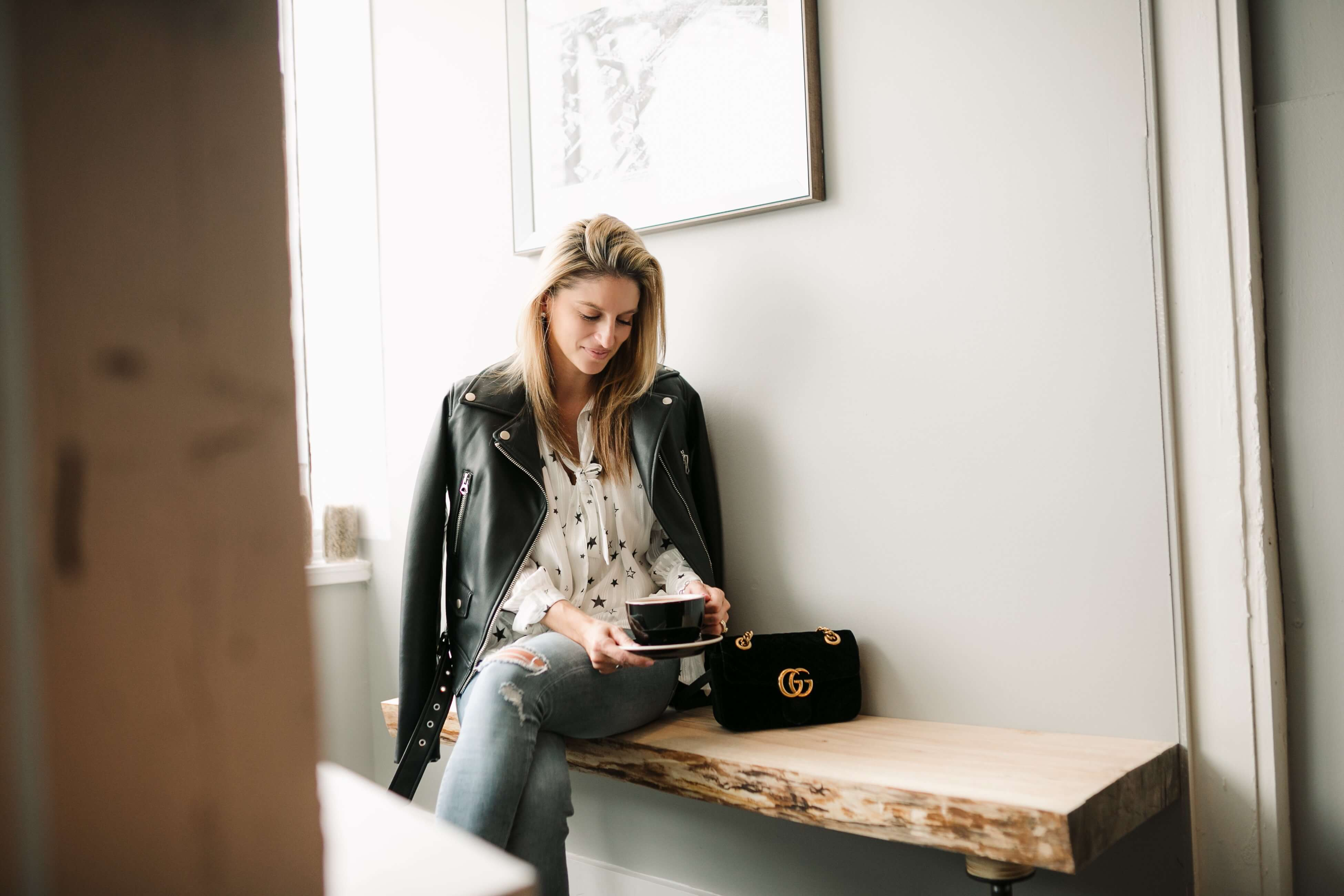 Chicwish star shirt; leather jacket; gucci velvet bag; Brock Street Expresso