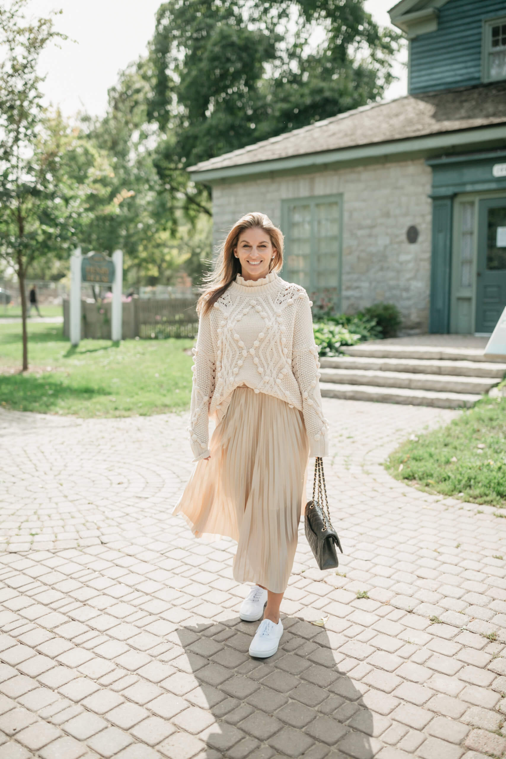 Chicwish HOLLOW OUT POM-POM CABLE KNIT SWEATER IN CREAM; chicwish FULL PLEATED MIDI SKIRT IN CHAMPAGNE; Fall look with maxi skirt; chanel flap bag; sparkleshinylove