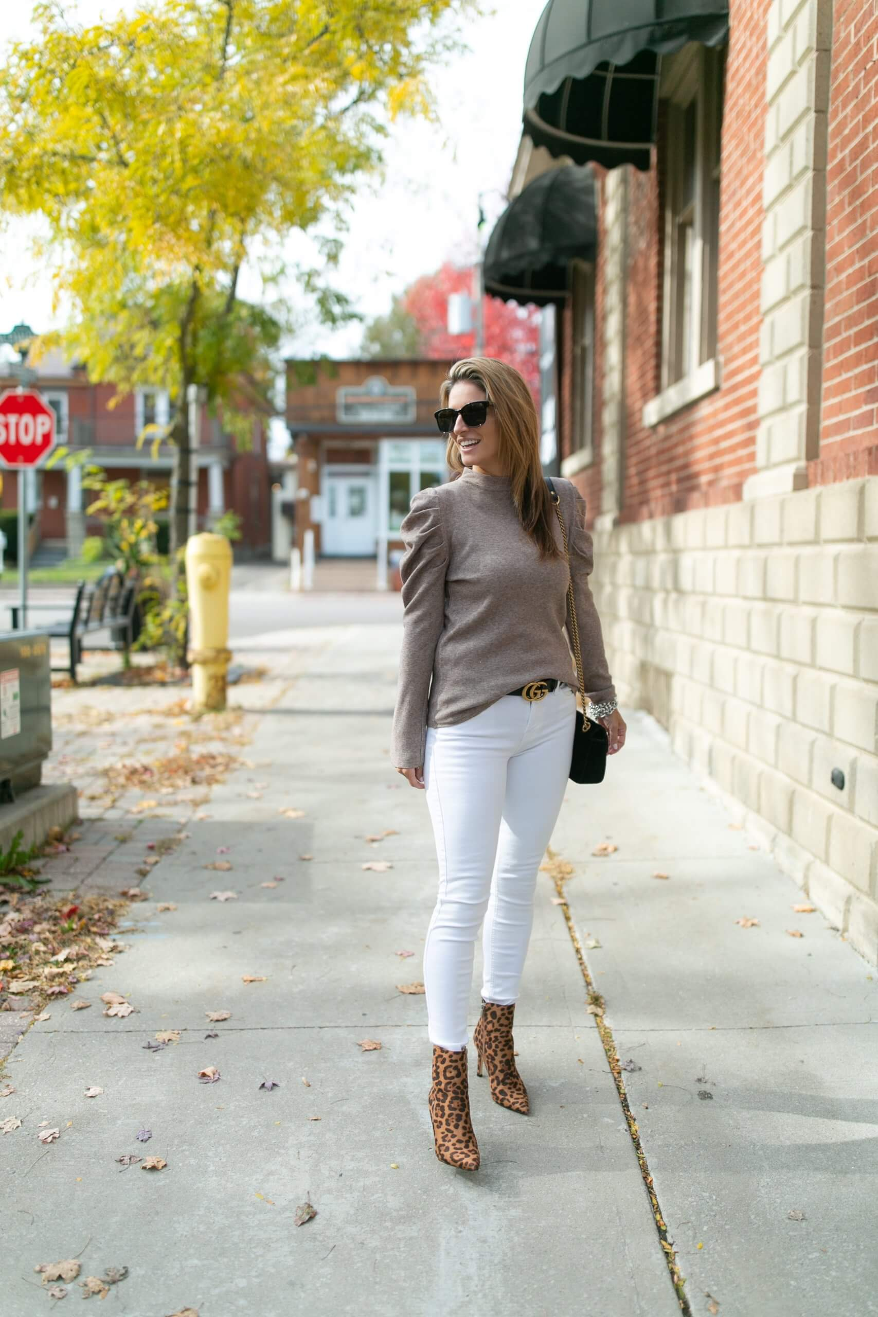 Winter white jeans; winter look with white jeans; detailed ruffle shoulder top; gucci belt; leopard boots; mandy furnis durham region blogger